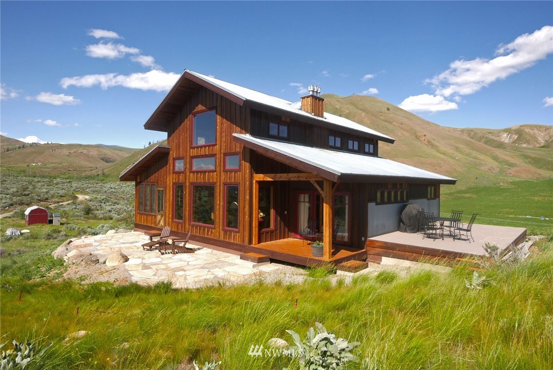 Exceptional Timberframe home w clean sophisticated lines. Masterpiece of expansive windows capture breathtaking mountain views & exposed interior beams honoring the grandeur of private setting. Attention to detail throughout! 3 bdrm/2.5 bath. Master suite w fireplace, Chef's kitchen, spacious family room, office/bonus space. Fabulous flowing efficient floorplan that connects w outdoor stone terraces & deck. Irreplaceable custom & artistic features. Convenient location to Winthrop & Twisp.