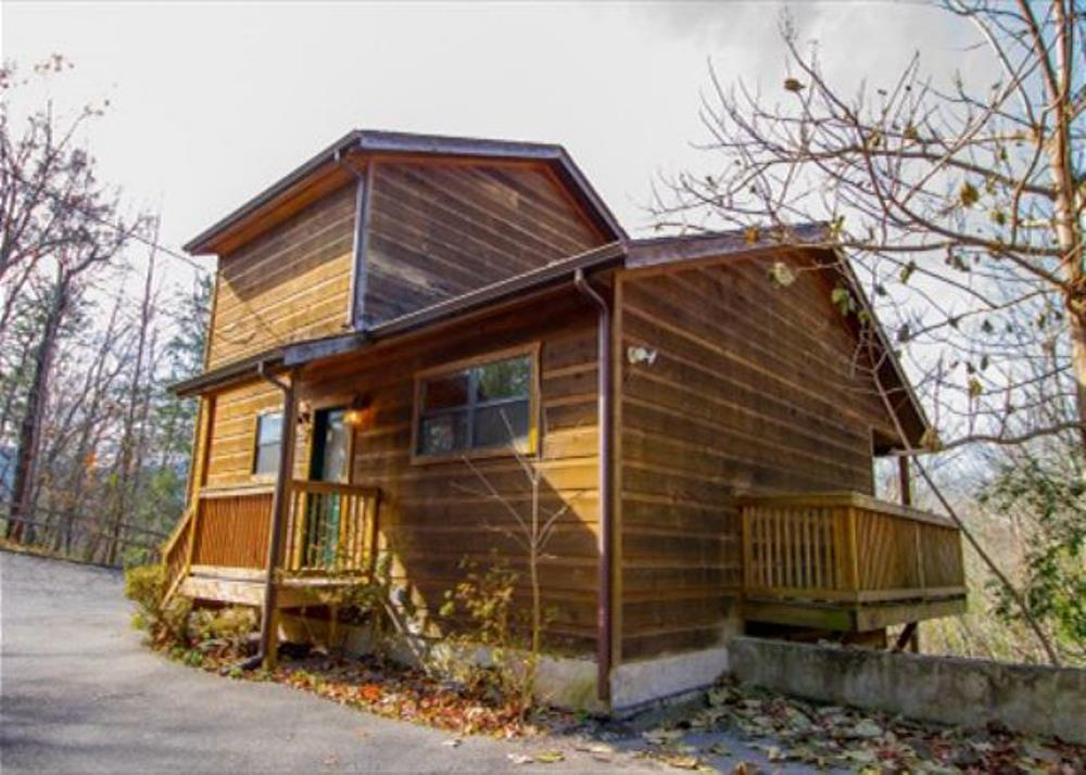 This is an amazing rental property located in the Private Village of Cobbly Nob.  Just 10 miles from the center of downtown Gatlinburg and Breath taking views of the Great Smoky Mountains National Park.  This is a great investment property that will be a rental income generator for years to come.  The home is being offered fully furnished and is ready to go on rentals.  This home features 3 king size master bedrooms with one on each level.  All  a rooms offer a large amount of space including kitchen, living room and game room.  The Village of Cobbly Nob is a quiet, relaxing, and scenic area offering views of the National Park that will never change.
