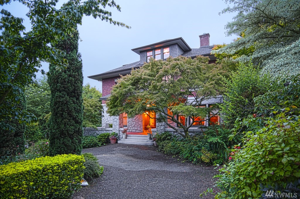 A magnificent historic craftsman home, also known as the Willis House built in 1909, commands pride of place in one of Queen Anne's most coveted neighborhoods.  This 7 bedroom, 6 bath estate sits on a majestic 12,800 SF double lot.  It boasts exotic imported hardwoods, hand made tiles adorn the fireplace and a unique circular driveway with a double entrance and a detached garage offer parking in abundance.  Formal rooms with high ceilings and utilitarian kitchen complete this unique property.