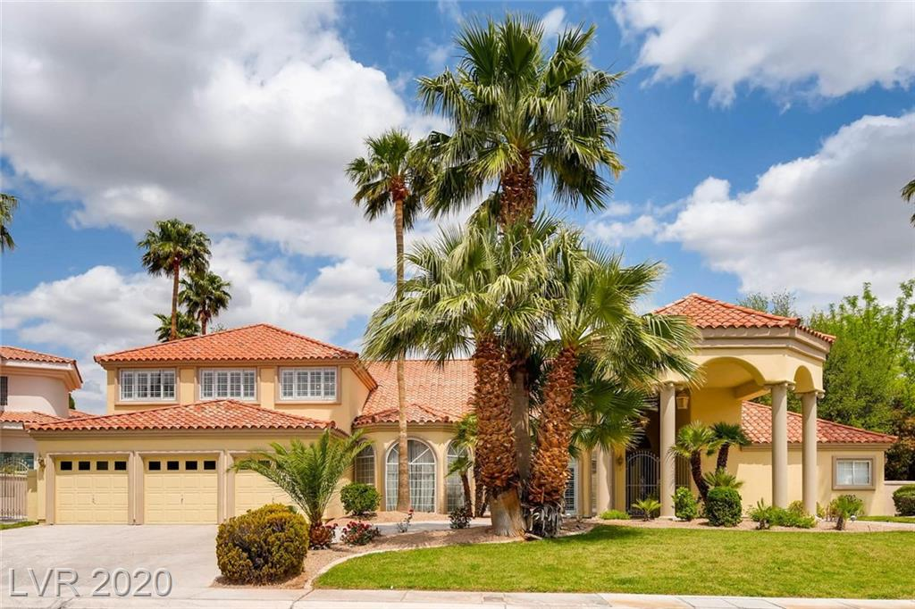 Gorgeous Spanish Trail Luxury Home, Amazing Fairway Views ! Custom home 6283sq (1st floor 4793sq, 2nd floor 1490sq) 5 Br & loft+5.5 bath on 0.38 acre lot. 3 Car Garage with circular driveway. Open Floor Plan, living room with view.  Master suite w/ sitting room open to the pool. Beautiful stone floors, lots of custom woodwork and detail. 2 Full wet bars, Large covered balcony overlooking golf view. Pool/SPA/Fountain waterfall and golf view !!
