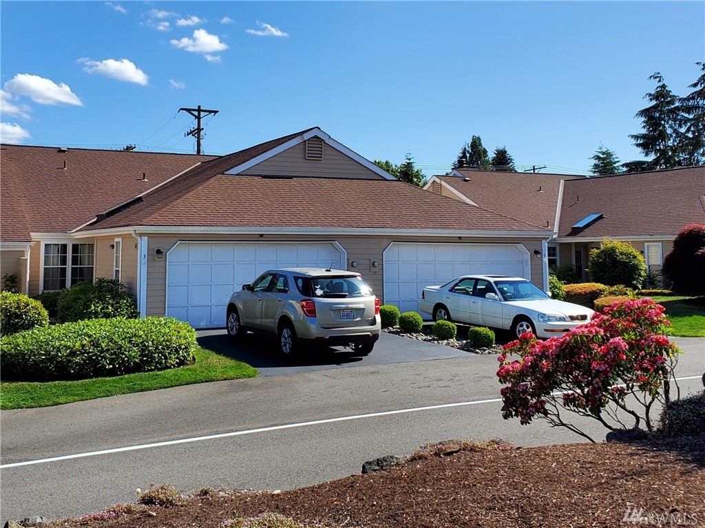 Are you looking for 1 Story living? You will love this end unit duplex condo in N. Tacoma offering many updates! This home features remodeled bathrooms, updated  windows, , & plenty of room! New vinyl planked flooring thru out, 2 bedrooms + 1.75 baths including full master suite w/walk in closet. The Living & Dining areas are spacious w vaulted ceilings & kitchen is open to the entertaining areas. The patio is private & fenced, plenty of storage in your 2 car garage & accessible attic space.