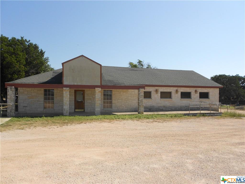 This commerical property is approximately 8 acres,  with 3 different structures on it.  There is the old Alfrado's restaurant, the owners house with 2Bd/1 bath apt on top of it, and 6 apts. on the side of it.  It is ideal for a business that is run by family and can live in the back.  The restaurant is in front with large dining rooms with big kitchen and two sets of restrooms.  The house is behind the restaurant with the 6 Apts. and the land lies south of the buildings.  It has multiple options for use.  Good location with lots of traffic.