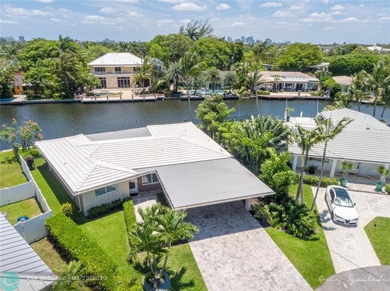 This is the waterfront home you've been waiting for! Imagine relaxing out back by the pool overlooking the river from this 3 bedroom 2 bath home in the Coral Shores neighborhood of Fort Lauderdale. A stunning contemporary home with wide expansive river views on a quiet cul-de-sac street, off the main road. Interior features a gorgeous modern chef's kitchen with Quartz counter-tops, stainless appliances and wine cooler. A split bedroom plan Terrazzo floors throughout the house. Hurricane Impact windows and doors. A wall of glass sliders that lead out to a large covered patio overlooking an infinity edge pool and waterway. Stack stone exterior, Newer Tile roof is less than 3 years old. Extra storage room. Lush tropical landscaping adorns the property. Marble pavers and so much more.
