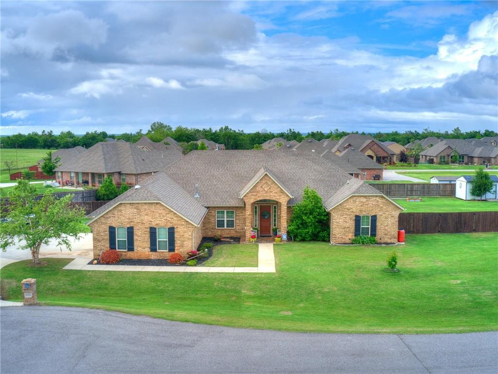 """Welcome to Landrun! Where all the lots in the neighborhood are 1/2 acre or more. The neighborhood offers a community pool and allows it's residents to build up to a 30X50 shop! Wow! This beautiful home offers 4 true bedrooms and a study, along with 3 full bathrooms. Two guest bedrooms are separated by """"Jack and Jill"""" bathroom, featuring their own private vanities. Inside the 3 car you will find the 8-10 person stand up storm shelter. This property is one of the largest in the neighborhood, boosting almost a full acre. The backyard is fully fenced and features a hot tub under a beautiful pergola. Plenty of room to add a custom pool to complete your own private oasis. Schedule your showing today!"""