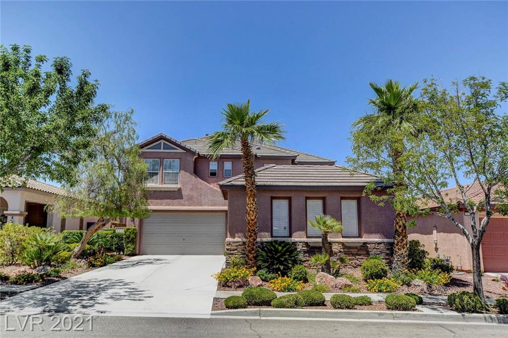 Sophisticated South Summelin home located in one of the most sought after locations In Las Vegas!  Walking distance to Downtown Summerlin, LV ballpark and hockey facilities. Vaulted ceilings, dramatic paint and showstopping finishes await you in this gorgeous home.  24x24 travertine tile downstairs and real hardwood upstairs.  Exquisite Hunter Douglas shades, custom drapes or Plantation Shutters cover most windows.  Owner has recently replaced both A/C's, pool pump and filter. No homes behind to block the Mountain views from the Primary Bedroom balcony. Primary bath with walk-in shower, large double vanities and hugh custom closet. Bedroom and full bath downstairs. Both  front and rear yards professionally landscaped and includes accent lighting that highlights the sparkling pool and spa with waterfalls. The gourmet kitchen with breakfast area and island/breakfast bar, opens to a spacious family room with a fireplace and designer touches.  Built in desk in the upstairs loft area.