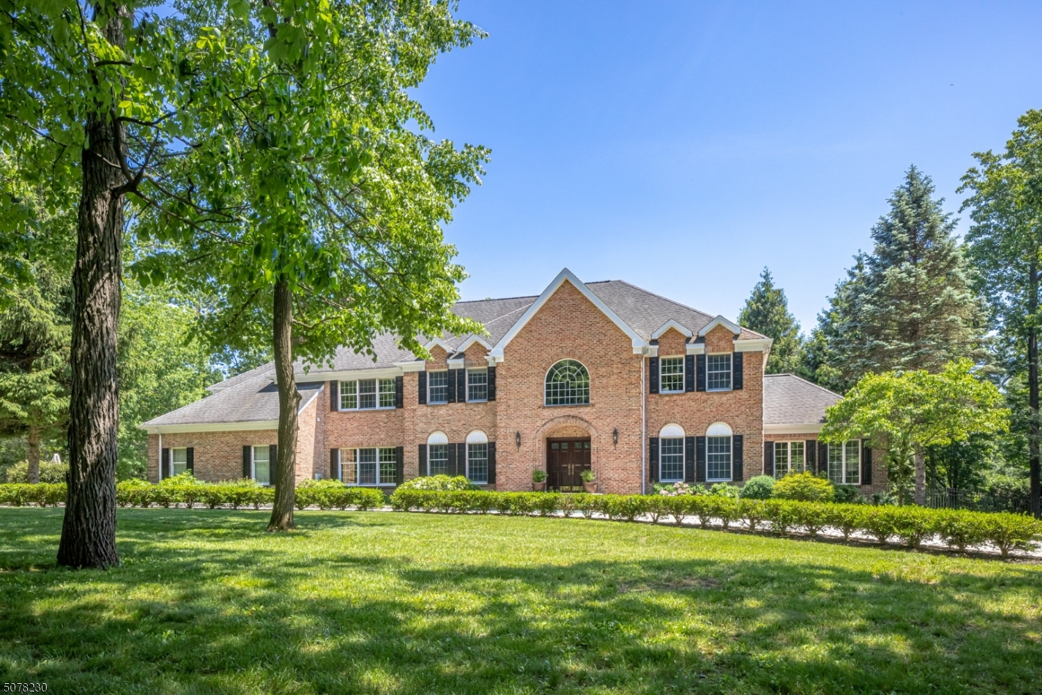 An exceptional Bernardsville neighborhood provides the setting for this spacious custom home on 1.57 acres. Raised paneling, extensive millwork, and hardwood flooring are found throughout. Three levels of living space include; Living Room, Dining Room, Butler's Pantry, Kitchen, expansive Family Room w/ Fireplace and Wet Bar, Library, Sunroom & Billiards Room/Office. On the 2nd level, the substantial Primary Suite offers privacy, bedroom with tray ceiling and fireplace, sitting room, bath, and large dual walk-in closets. Four additional bedrooms, 2 ensuite, and a laundry room complete this level. The finished lower level includes TV Area, Arts & Crafts room with half bath, Wine & Exercise Rooms. The impressive bluestone patio overlooks the open, rear yard. Circular paver drive with 4-car garage.