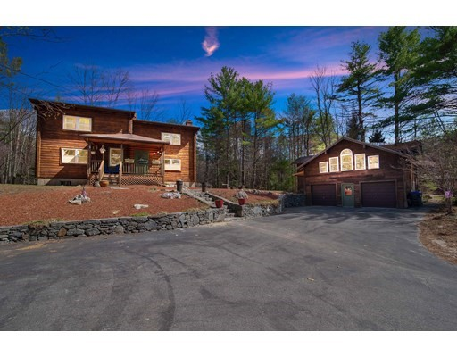 Serenity at it's best! This 3 Bed, 2.5 Bath contemporary chic custom built log cabin has it all! A huge driveway, copper flashings, dry stacked stone pillars & retaining walls invite you into the 1.69 wooded acres to escape the city life. Kick off your shoes in your heated mudroom with a custom bench seat & storage. Relax by the fireplace to watch TV or cook for your guests sitting at the island with your gas range and modern S/S appliances. Read a book, entertain, or grow flowers & vegetables in your radiant heated full size solarium! Use your imagination for the finished basement and make it into a game room. All bedrooms have cathedral ceilings and the giant master suite has two full sized closets and a full bath. The Harvey windows allow for tons of natural light to pour in. Park in the oversized heated garage with a massive apartment above with Japanese soaking tubs, bathroom, heat, hot water for in-law, studio, etc. Walking distance to hiking trails & the beach at Lake Dennison!