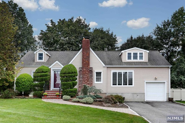 """Wow! 2,473 sq ft of living space in this """"Move right in"""" Colonial cape! Front paver walkway invites you into this beautiful home with room for everyone! Entry hall w/guest closet, Formal dining room, Living room w/WB FP, which is open to Fam Rm w/ent to deep (1.5 car)garage & amazing Eat-in-kitchen w/center island, breakfast bar, granite counters, SS appliances & sliding glass doors to fenced yard & patio. First floor also has a bedroom & full bath (perfect for guests!). The expanded 2nd floor boasts a large primary bedroom w/wic & Full bath (dual entry) to Br #2, Br #3, Br #4 and full bath. (note: Br converted to WIC, shelving can be left or taken down). Basement consists of a finished rec room, full bath, utility area, laundry & cedar closet! Other features include, 2 zone heating & central air, 200 amp electric, & much more!So much detail, charm & thought has gone into this home which is located on an almost dead-end with park across the street & short distance to NYC Trans!"""