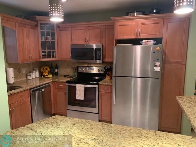 WHAT A PRICE REDUCTION!! welcome home to a spacious, updated condo on the first floor of a well maintained building.  Plenty of parking.ALL AGES. close to A+ coral springs schools.community is small pet friendly.  The kitchen is open with granite counters and stainless steel appliances.  marble backsplash.  the master bath is updated with marble walls and floors.  the unit is spotlessly maintained with light tiles on the floor.  AS for the building, the seller will pay the present assessment at closing.  Upgrades to be completed- painting, new roof, upgrade elevators inside and mechanical, new sump pump, new pavers around pool, pool re-marcited, etc.  (IN OTHER WORDS, NO FUTURE assessments ) and the maintenance is so affordable!(cable not included) COME SEE..u wont be disappointed.