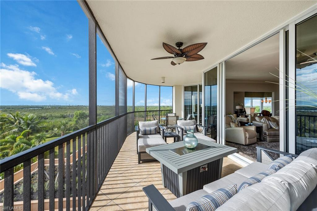 Take in gorgeous, panoramic Bay, mangrove & Marco skyline views from this fantastic 4BR/3.5BA condo in the luxurious golf community of Lesina in Hammock Bay. This unit is nearly 3,000 sq ft under air, has private elevator, grand foyer & wraparound balcony. Open floor plan flows from room to room & offers plenty of entertaining space, connecting living room, kitchen, family room & formal dining room. Highlights include tile floors on the diagonal in main living areas, crown molding, tray ceilings, custom mirrors & light fixtures, faux painting, new, natural cracked sandstone wall around fireplace in living room & solar tinted windows. Gourmet kitchen has ample counter space & cabinets, SS appliances, pantry, breakfast bar & breakfast nook. Master suite has private balcony access, walk-in closet, dual sinks, enclosed WC, shower & separate jetted tub. 3 extra bedrooms with private balconies, on the split plan, for guests' privacy. Watch spectacular nightly sunsets from the balcony. Enjoy world-class amenities - tropical resort-style pool, private cabanas, social room & kitchen, 2 guest suites, theater, fitness center, & poolside dining. Optional tennis memberships are available.
