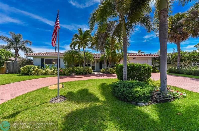 LOCATION PREMIUM in Lighthouse Point's most soughtafter Venetian Isles neighborhood surrounded by million $ waterfront homes just a few blocks from Lighthouse Point Yacht & Tennis Club.  This lovely renovated home features:  open kitchen w/wood cabinetry, updated baths, split bedroom plan, new flooring throughout the wide open floor plan including 24x17 family rm w/French doors and lots of space for entertaining, newer roof and 2 energy efficient A/C systems, new hot wtr heater, hurricane impact windows, inside laundry, hurricane impact garage door and even space to keep your boat in the fenced side yard.   Enjoy the beautifully landscaped fenced backyard and large patio space, beautiful city parks, restaurants, marinas, shopping & nearby beaches.  This lovely home awaits you!