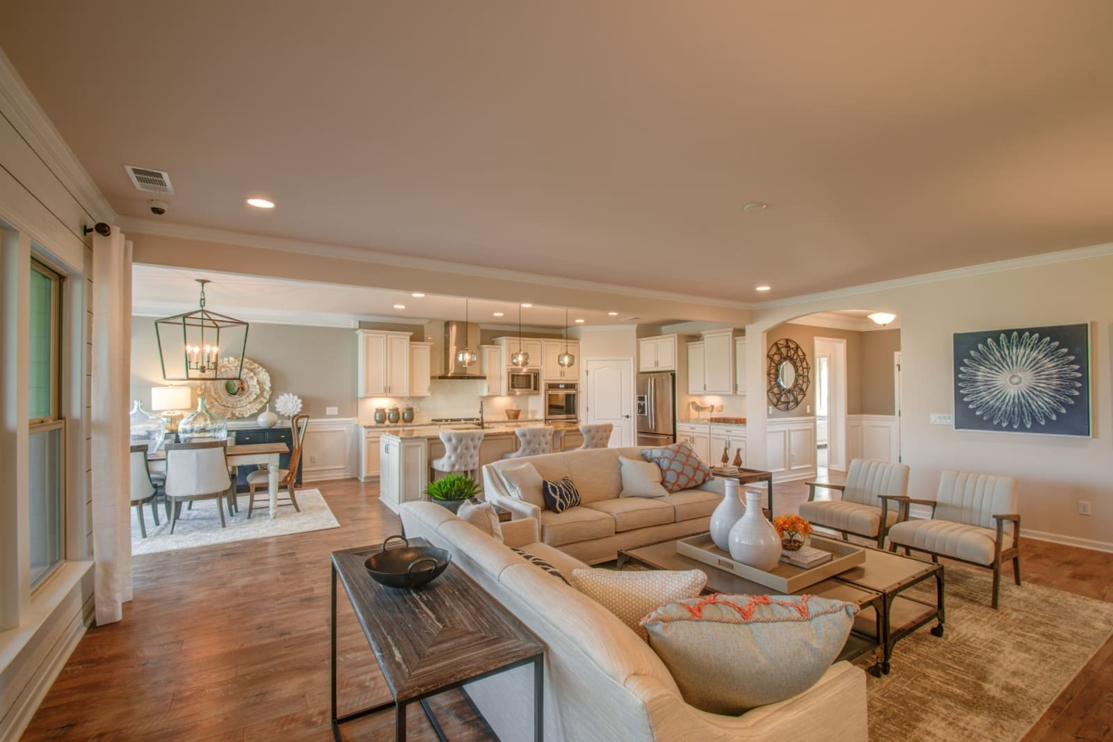 Dunwoody Way featuring stacked stone fireplace, dual owner's suite, 4' garage extension, separate library with walk up attic storage in garage. AMENITIES GALORE: resort style pool, tennis courts, pickleball courts, yoga studio, dog park, gym, ballroom, 13 miles of sidewalk and more
