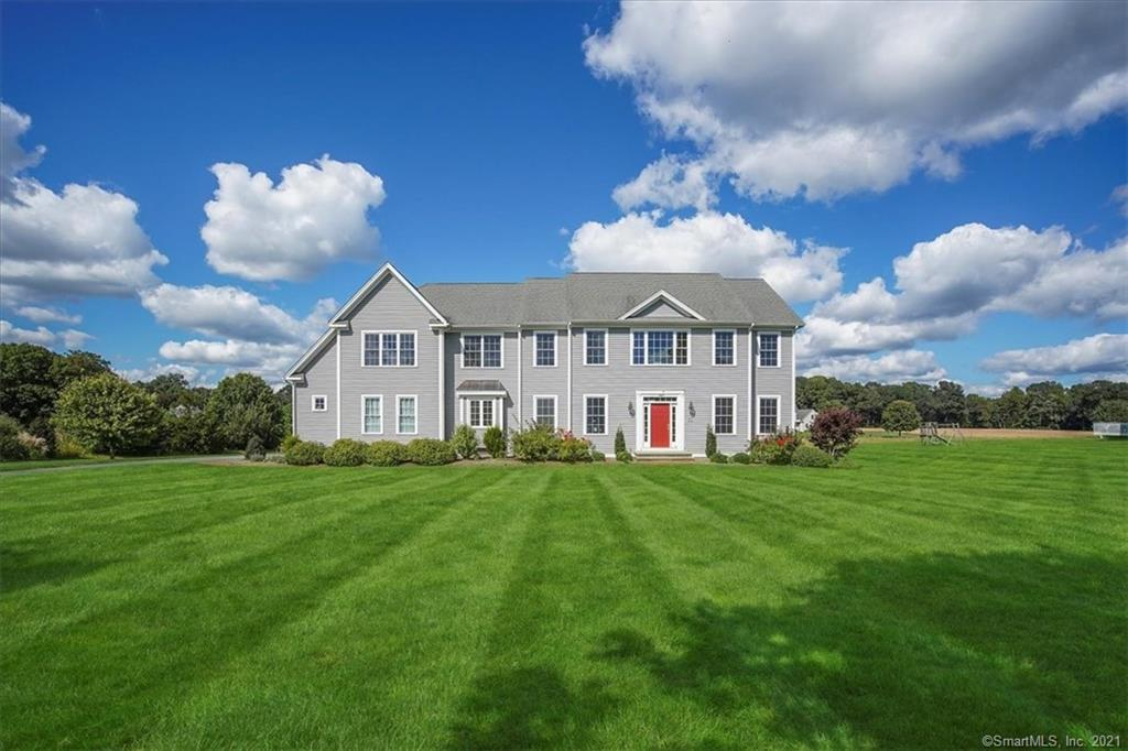 Beautiful 5 bedroom colonial in desired South Glastonbury, on level 1.84 acres.  Bright and open layout with 9' ceilings on both levels, hardwood floors and moldings.  Enter into grand foyer, living area on right dining on left, straight ahead the cathedral family room with gas fireplace opens to large kitchen with island, granite, induction stove top, plumbed for a gas stove, and plumbed cabinet for wine cooler.  Off the kitchen to mudroom has a large walk-in pantry and laundry room, also on first floor is office and half bath. Upstairs to master bed, updated bath and walk-in closet, down the hall to 4 bedrooms (one with full bath), hall bath and very large bonus room (could be au pair). Attached 3 car garage with electric vehicle charger, composite deck, irrigation, security system, central vac, generator hook up, shed and newer AC and furnace.  There is conservation easement in back portion of property, can be mowed twice a year.