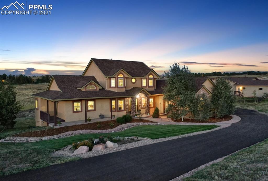 Truly An Amazing Custom Home on 2.67 Acres In Award Winning School District 38. Outside You Will Enjoy Sweeping Views On The Wrap Around Front Porch, A Spacious Back Deck And Covered Outdoor Patio. When You Step Inside You'll Be Greeted By A Timeless Floor Plan Designed With Multiple Open Living Spaces for Entertaining And Additional Private Spaces To Easily Work From Home Or Get In A Quick Workout. The Home Boasts Arched Windows, Vaulted Ceilings, A Gourmet Kitchen, Hardwood Floors, Upgraded Cabinets, Slate Counters, Stainless Steel Appliances, Chef's Pantry, Gas Cooktop, Double Oven and A Dining Nook With Double Doors That Opens To A Large Trex Deck. The Kitchen Has An Oversized Island That Allows Plenty Of Room For Extra Hands In The Kitchen. The Large Family Room Flows From The Dining Nook And Features A Gas Fireplace Surrounded By Stone and Built-In Shelves. The Main Level Also Features A Vaulted Master Suite With A 5-Piece Bathroom En Suite Where You Will Enjoy A Soaking Tub, Free Standing Shower, Double Vanity And Walk-in Closet. An Office With French Doors And A Private Dining Room With Bay Windows Complete The Main Level. Upstairs Features A Bedroom With Private Bath and 2 Additional Generous Sized Bedrooms Sharing A Full Bath. The Lower Level Features a 5th Bedroom With Bathroom And Large Flex Room That Easily Accommodates A Workout Room, Home School Room or Music Practice Room.  On The Lower Level You Will Also Find A First Class Theater Room And Convenient Wet Bar Allowing You To Easily Enjoy A Relaxing Night At The Movies With Family And Friends. The Oversized 3 Car Garage Is A Dream With A Hot/Cold Water Spigot, Service Door, Finished Walls, Lots Of Storage, High Ceilings And Its Own Furnace To Stay Warm While Working In The Garage During Colorado Winters. This Scenic Property Has Convenient Access to I-25 And Hwy 83 Making It An Easy Commute To Colorado Springs And Denver. With A New Roof In 2019, This Well-Maintained Home Is Move-In Ready!