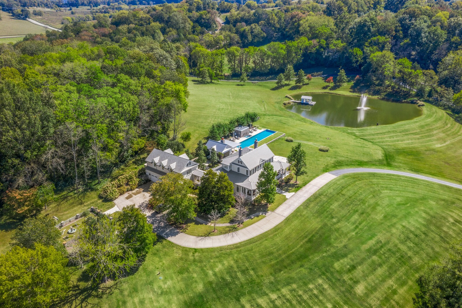 39+/- acres with two homes in heart of Leipers Fork. Main house is a cozy 3 BR 3.5 Bath farmhouse with breathtaking, preserved views. Two fireplaces with limestone mantles from LA. Gavin Duke designed outdoor dining/entertaining area with two fireplaces, built in gas bbq, ice maker, and refrigerator. Salt infinity edge pool overlooks a fountain fish pond with an outdoor bath attached to the spa. Above a 3 car garage is a 1 BR 1 Bath apartment. Formal garden, and includes 3377 Bailey Rd studio