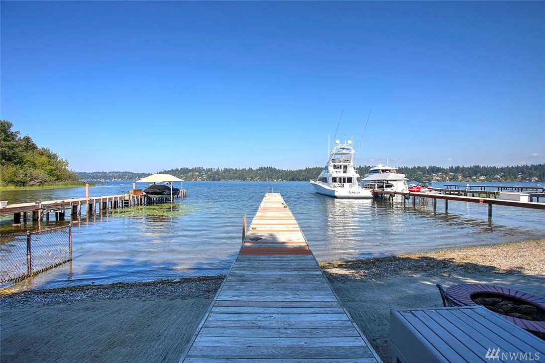 SHARED WATERFRONT in sought after North Mercer! Within walking distance to Luther Burbank Park, DT Mercer & the future light rail. This home will amaze you with its expansive living space w/ 180 degree lake & city views, large chefs kitchen w/ built-in wok, wrap-around deck, large master suite w/ steam shower, sauna and HUGE walk-in closet & potential mother-in-law on lower level all with elevator access. Step out back to your private zen garden w/ cascading water features, gazebo & koi pond!
