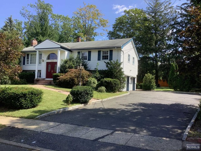 Beautiful home in the heart of Paramus with 4 large bedrooms and 2 1/2 baths. There is a wood burning fireplace and plenty of storage. Newer kitchen with SS appliances with open space to DIN and LIV. Hardwood floors all in. Central Air and great space for your potential pool or swings. Pride of ownership. All you have to do is unpack and start making memories in your new home. Come see this gem before it is gone! Virtual tour attached.