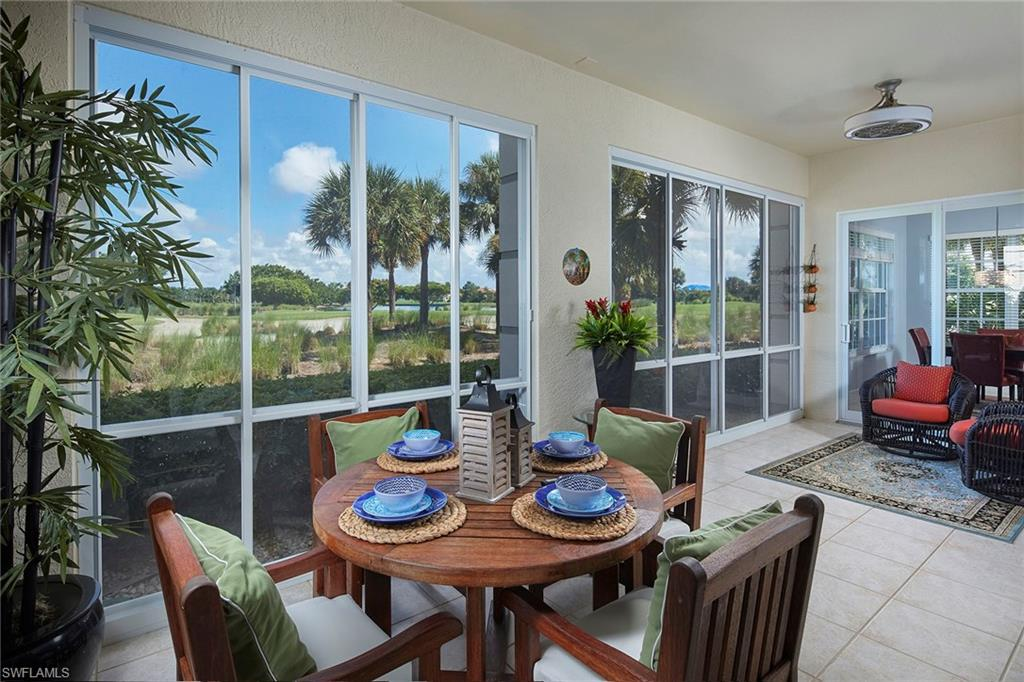 """Stunning 1st floor golf course residence in Osprey Pointe at Pelican Marsh. Imagine sitting on your """"all weather"""" enclosed lanai and enjoying the beautiful, endless views of rolling fairways, lake and landscaped areas.  Over $50,000 in recent upgrades including interior paint, designer lighting and fans, kitchen appliances, window treatments, flooring and impact glass windows and sliding doors.  This 2 bedroom + den, 2.5 bath, Great Room plan offers split bedrooms, spacious kitchen and morning room, attached 2 car garage, laundry room with cabinets and sink. Tray ceilings, crown moldings, art niches and tile flooring in all main areas. Elegant master suite with huge walk in closet, double vanities, garden tub and separate shower.  Enjoy the community pool and spa, fitness center and all amenities Pelican Marsh offers."""
