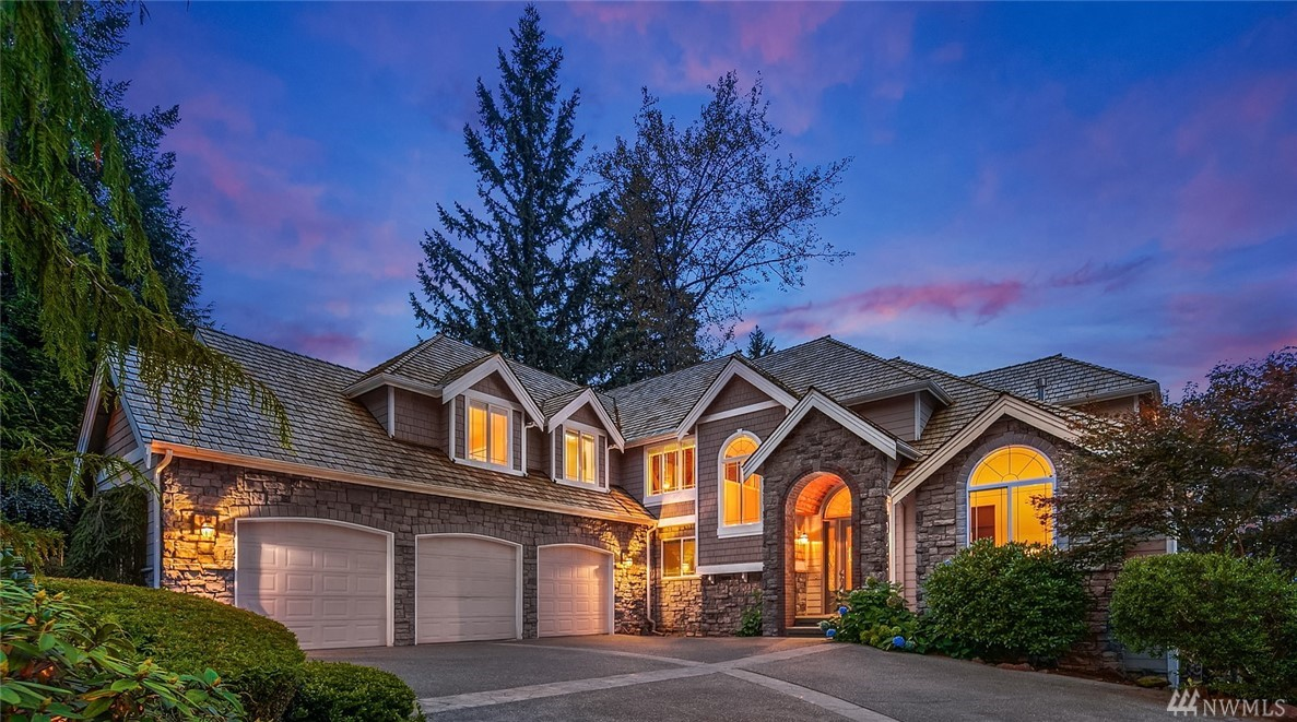Exceptional custom home blends luxury with PNW architecture. Enjoy indoor & outdoor living with formal & everyday gathering spaces. Towering windows with lake views, light-filled great room with 2-story open beam ceilings, gourmet kitchen, wine cellar & movie theater are perfect for indoor gatherings. Manicured grounds give a private, park like feel and the covered patio with outdoor kitchen & fire pit offer fabulous outdoor living. Turnkey with new carpet, paint, appliances & bathroom updates.