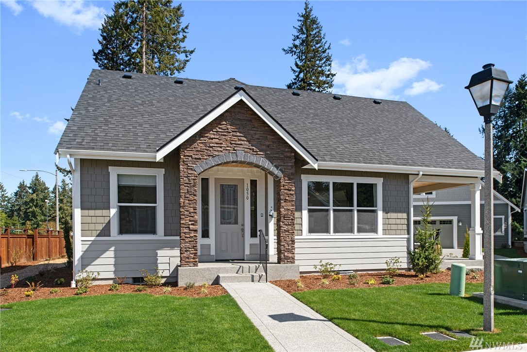 STUNNING NEW CONSTRUCTION! Why pour more money into your current home when you can have NEW? The Pebble Beach plan features luxurious amenities: Bosch appliances, designer paint, quartz counter tops, beautiful hardwoods - just to name a few. Enjoy your master bedroom and all the living on the main floor! Private retreat upstairs w/generous guest suite, full bath & loft. Already 18 homes sold in 11th Tee! Going FAST - open daily!