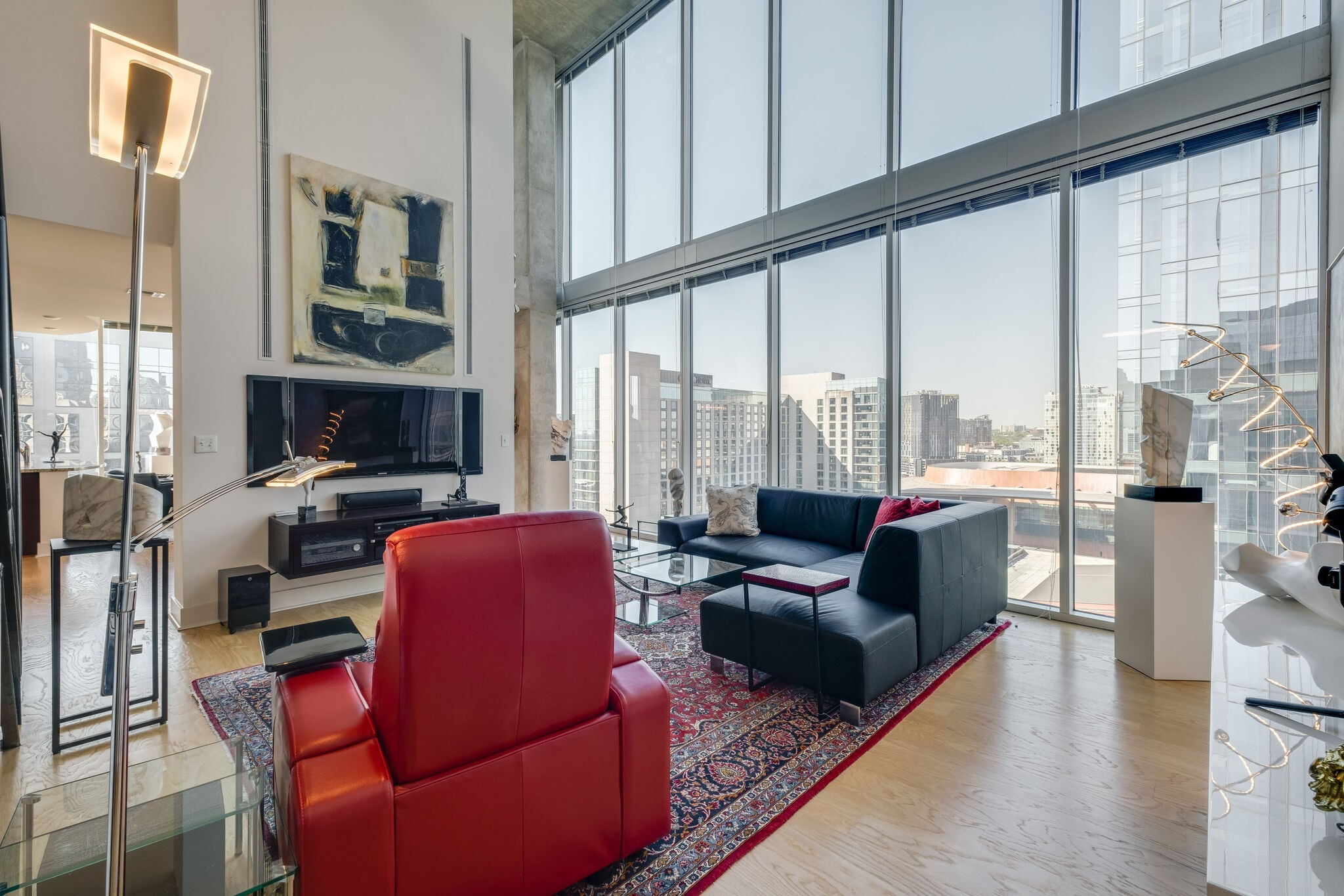 Luxury in the heart of Nashville! This 2 bedroom, 2.5 bath Encore condo is absolutely breathtaking. At just over 2,000 sqft, this unit has many unique features: 25ft floor to ceiling windows, two private terraces that allow you to look as far as the eye can see over downtown, two premium parking spots, and amazing amenities like the gym, clubhouse, pool, and concierge. All of this and within a 2 minute walk to Broadway!! See video in link!