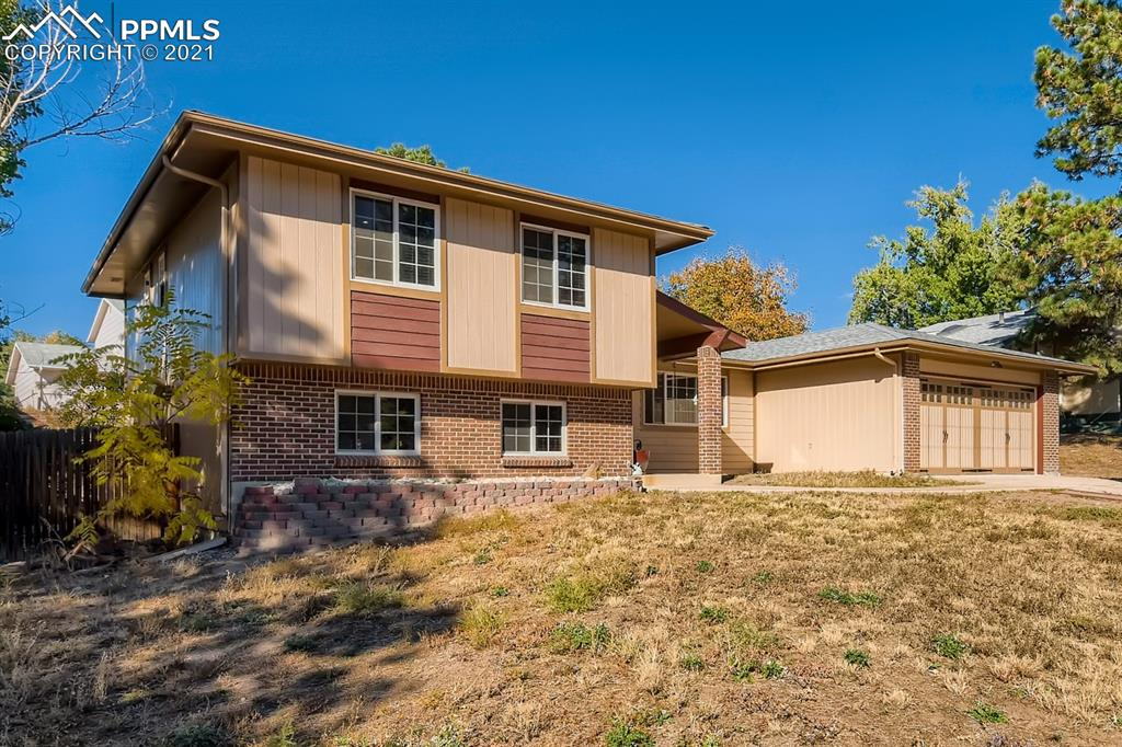 Beautiful tri-level home in the Vista Grande area! Centrally located home, in a quiet tree lined neighborhood, that is close to many essential businesses as well as I-25. This charming 4 bed, 3 bath home has a spacious layout, featuring 2 living areas, a beautiful fireplace, as well as a large backyard with mature trees. New carpet, updated bathrooms and flooring. Come and see it, before it's gone!