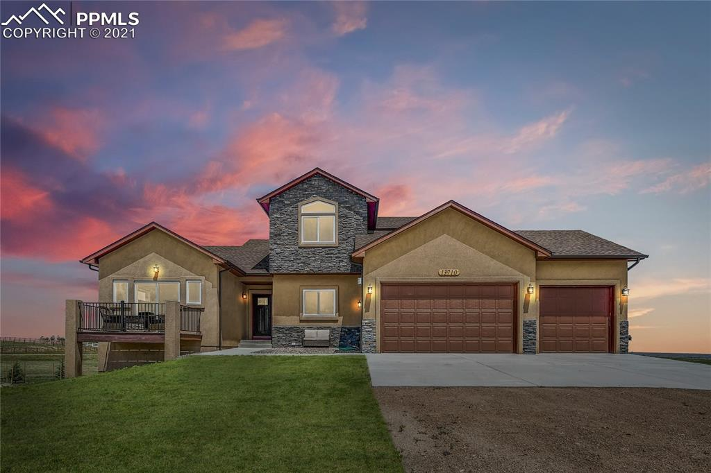 Why build when you can buy practically new? Don't wait, this 6 month old home is ready to go. Beautiful 2-story with all the bells and whistles on 4.75 acres &main level living. Master bedroom &laundry on main, hardwood throughout main level living areas & lots of upgrades. Located on popular Trails area on a corner lot w/AMAZING Pikes Peak views/culdesac location. Five bedrooms, four baths, formal living & dining, & rec area plus master bath marble, upgraded cabinetry, &more paved roads, close to schools, shopping, & golf