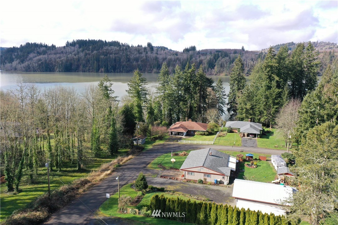 Walk to the lake! This is a cozy & unique home, 2 beds with room for a den/office or additional bedroom. Enjoy the propane fireplace w/copper hood! Nice sized shop to park your boat. Better hurry!