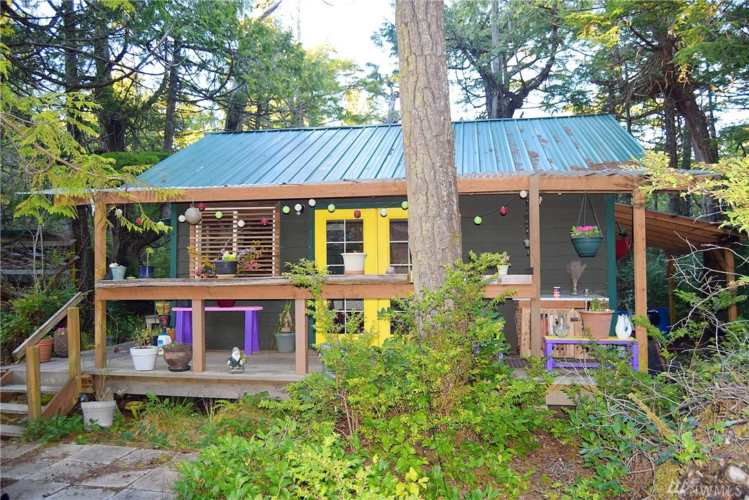 Awesome off-grid retreat. 2 quaint cabins: One has wood stove, and other is propane heat. Water is collected in barrels. Wired for lights and outlets. Generator Ready. 12x30 RV cover, 6x8 greenhouse, 16x16 covered area w/rough sawn beams from the property, 10x12 outbuilding. An enclosed compost toilet and an outdoor shower. Two driveways provide parking for several RV's. Space remains to build a large home. Located a short walk from the Ocean Crest Resort with health club, restaurant and beach.