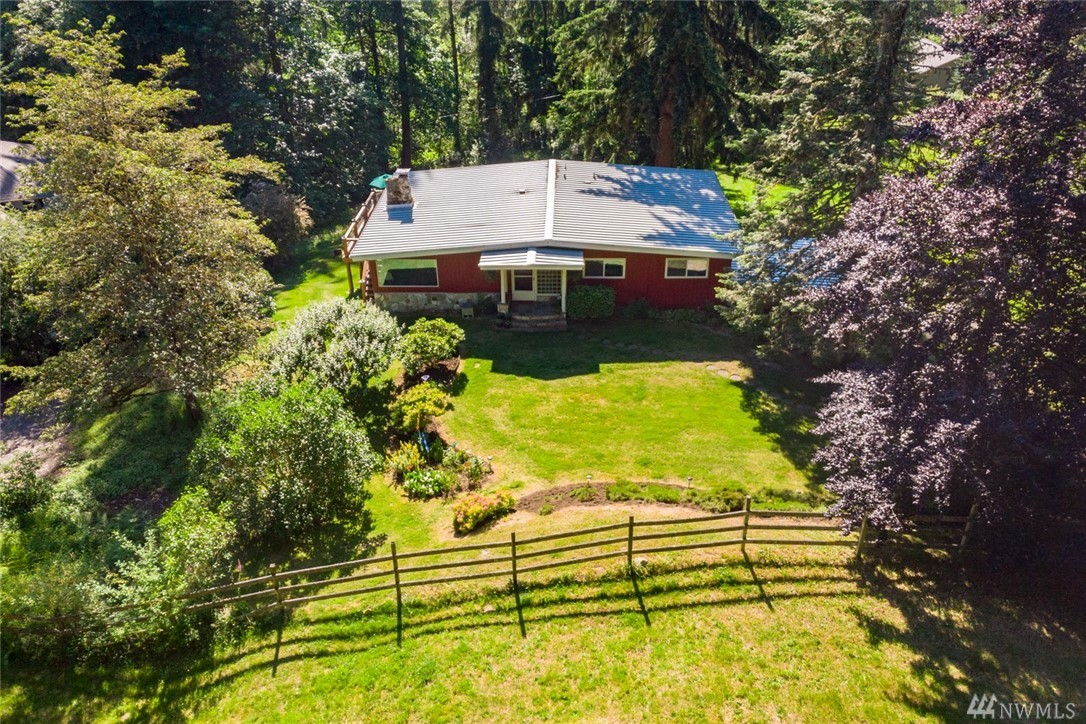 First time on market - Good bones! Equestrian property & 2 stall barn. Owners meticulously maintained this 4 bedroom Mid Century home on 2.55 acres. Partially fenced pasture, fruit trees, garden, and greenhouse. Wrap around deck looks over quiet, park like setting. Lake Washington schools. Close in to Redmond, MSFT, Bellevue and 520.  25 years left on standing seam metal roof. Possible MIL. Union Hill water, gas at street. House is well situated to the site.Freezer & generator included.
