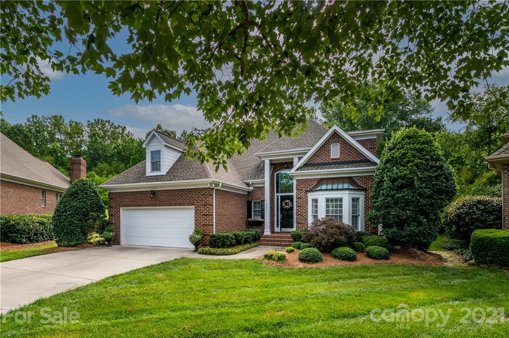 Stunning brick home, with a beautiful private backyard, located in the heart of South Charlotte in the prestigious TPC Piper Glen Golf Course Community! Custom built by Simonini Homes, The Enclave at Piper Glen, is located within walking distance to Four Mile Creek Greenway, Trader Joe's & Starbucks. The HOA provides lawn maintenance for a carefree lifestyle! Quick access to Hwy. 485 & Hwy. 77 - plus direct in-town roads to uptown Charlotte. Close to fantastic dining and shopping options (Stonecrest, Blakeney, Ballantyne, and Waverly) This home has a large owner's suite on the main floor with a recently remodeled owner's bath & walk-in closet. The cook's kitchen has white cabinets, center island, walk-in pantry & gorgeous high-end granite countertops, and backsplash. The great room features a gas fireplace flanked by built-in bookcases. Upper floor with 3 bedrooms, large loft/bonus room & walk-in attic storage. 2 car garage. Amazing back deck/patio area with travertine flooring.