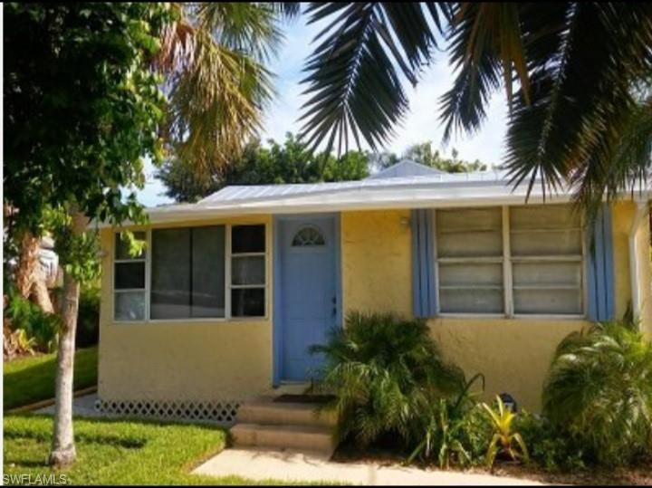 Old Florida Cottage with a Main House and private In-Law Suite with a separate entrance in a lush Palm Garden setting in Bayshore near Bayview Park and Naples Botanical Gardens.  Cycle around Lake Avalon at Sugden Park or grab a bite at Celebration Park.  Publix, restaurants, banks and shopping are all very close.  Bayshore is located just 10 minutes drive to infamous 5th Ave S, The Naples Pier. and Naples Beaches.  Great investment opportunity to get in Bayshore with opportunity to live in one and rent the other.  Currently both the main house and the In-law suite are rented separately and generate $2200 gross rent monthly.  Tenants have rented for two years and are good tenants, no problems and always pay rent on time.  Seller pays utilities, wifi, and lawncare.  Property is zoned BMUD-R2 RMF 6. You could demo current house and build a duplex.  Serious buyers only!  Seller doesn't want tenants disturbed and is firm on price.  Selling As-Is.