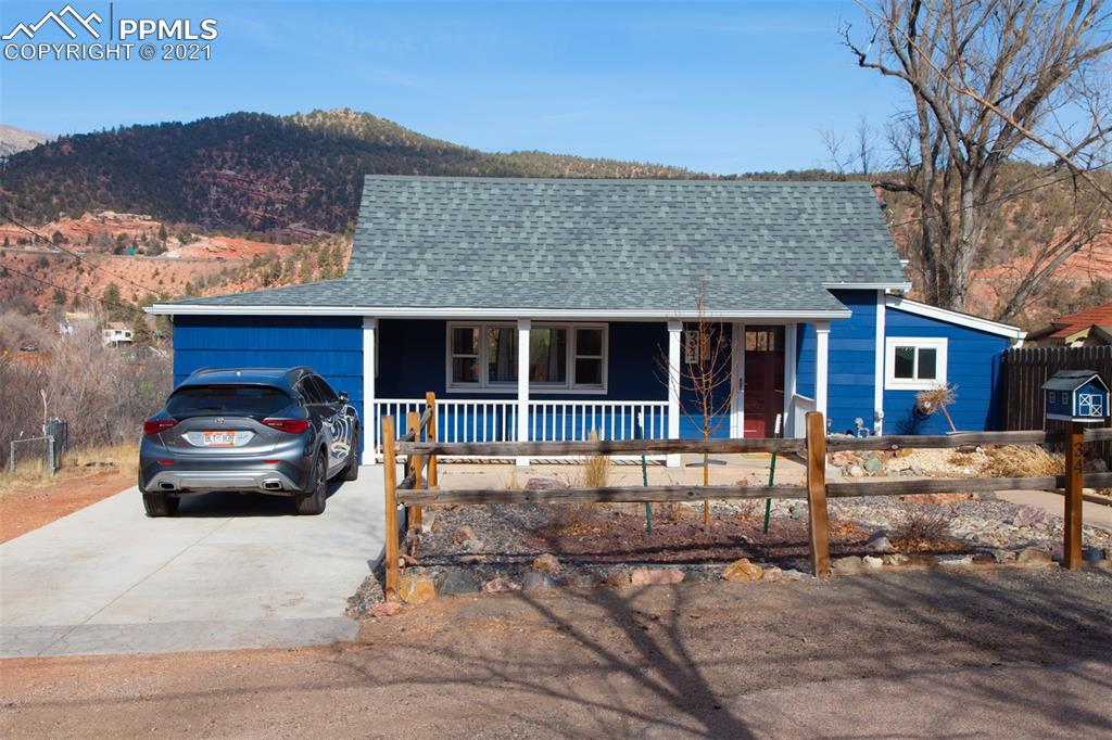 The most amazing views from the home, including all of Manitou Springs, the Incline and Pikes Peak! Completely remodeled home from the outside to the inside. The modern kitchen design includes granite countertop, tile backsplash and stainless steel appliances. The beautiful modern style full bathroom includes porcelain tile flooring and shower, marble countertop and marble tile in the shower floor. Notice the attention to design with the tongue and groove wood ceiling in the living room and the wood burning stove fireplace. The backyard has a large composite deck with a metal railing, to enjoy the amazing mountain views. The completely fenced backyard has no maintenance landscaping including rock and artificial turf. THE AVAILABLE PARKING IS JUST THE 2 CAR DRIVEWAY, NO GARAGE.