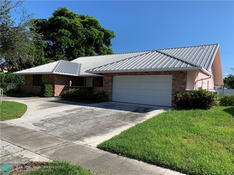 VENETIAN ISLE GEM... Three Bedroom Two and a Half bath with den/sitting area pool home. Features include metal roof, newer AC unit, Wood Floors and large covered pool area. ready to move in or add your own touches, you won't want to miss this one...