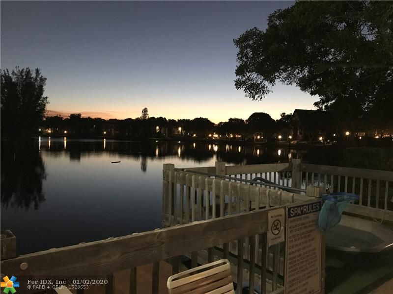 Best deal in The International Village, 2 bed 2 bath split floor plan newer laminate flooring in lr and dining room. Newer vanity's, sinks and toilets in bathrooms, newer raised panel interior doors. Seller will give a $1500.00 credit to change carpet in bedrooms with a full price offer. Gorgeous views of the canal and golf course from balcony. Community features indoor/outdoor pools and Jacuzzi, gym, tennis courts and 24 hr manned security at the gate. Don't miss this one!