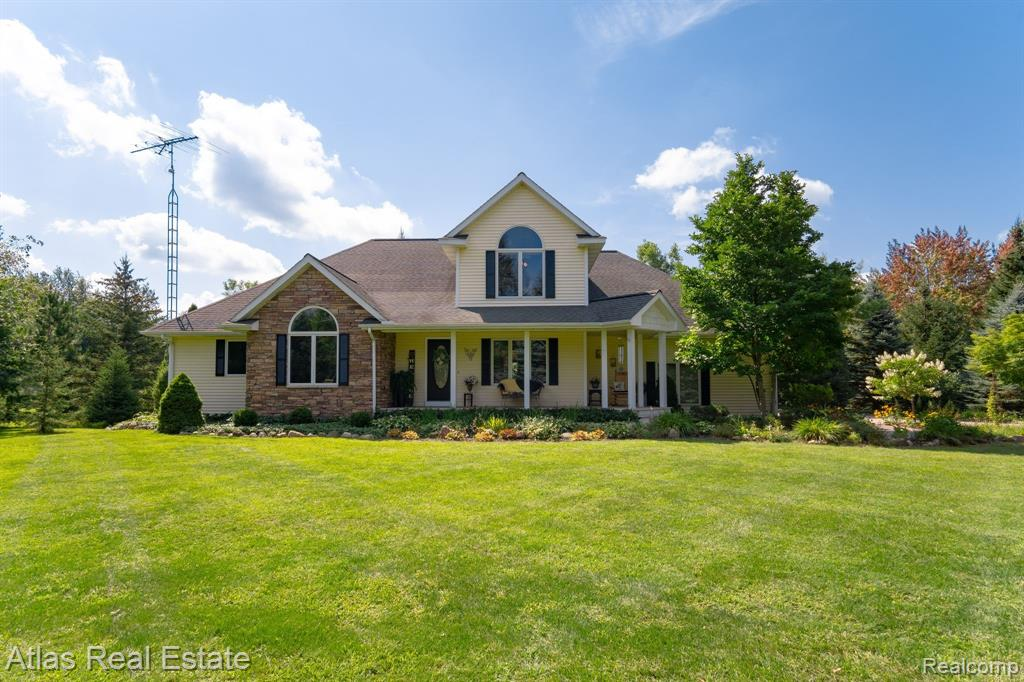 """Custom Built - Energy Efficient Home - Goodrich Schools - Situated on 7.97 acres - Secluded park like setting.  Immaculate one family home with a 3 car garage.  Many updates and extra's - too many to list!!  5 bedrooms (4th bed/den, 5th is in lower level). 2 Full bathrooms - two 1/2 bathrooms, 2nd floor bridge over looking great room with a natural stone - wood fireplace system.  Kitchen with maple cabinets & new granite, lots of hardwood flooring.  First floor master suite bathroom includes large jetted tub and separate 4' walk-in new ceramic shower.  Finished daylight basement with a large family room, bedroom, half bathroom, craft room, workshop (13x26) and lots of storage (12x21).  Stamped concrete walkways.  Beautiful property with a pond, nature trails w/wood boardwalks - leading to multiple paths in the woods.  30""""x40' pole barn w/cements floor and 220v/60 amp electric service. *H.O.A fees:  $660 per year.  Includes weekly trash & recycling. Road Maintenance & snow removal."""