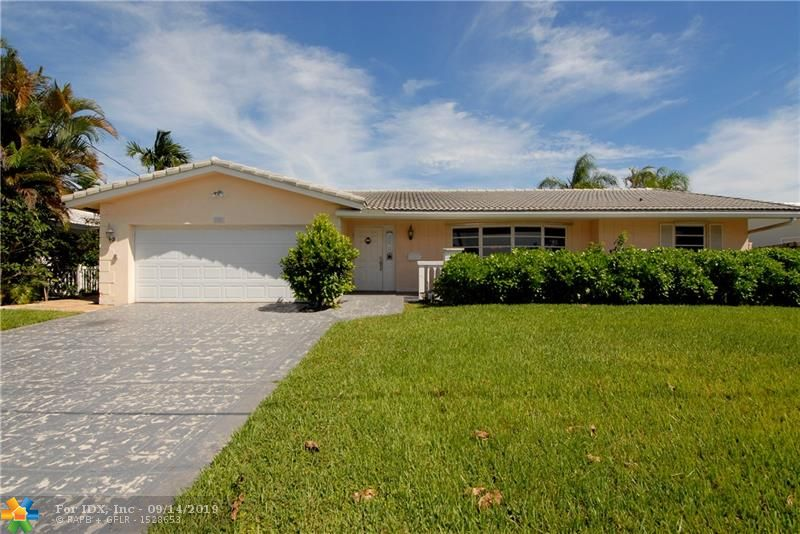 REDUCED -OWNER WANTS OFFER!! CORAL RIDGE ISLES/ 5 BEDROOM, 3 BATH FAMILY HOME. 2729 FEET LIVING AREA.  EAST WING HAS TWO MASTERS. ONE BEDROOM HAS RENOVATED BATH WITH TUB AND SHOWER.  WEST WING HAS 3 BEDROOMS, ONE BATH -PERFECT FOR A MOTHER/FATHER IN LAW SUITE!   KITCHEN HAS LARGE EAT-IN AREA WITH BEAUTIFUL BUILT-IN BUFFET.  FORMAL DINING ROOM.   MASSIVE FAMILY ROOM OVERLOOKING THE POOL, DOCK AND CANAL.  NEWER DOCK IS 75' ON THE CANAL WITH OCEAN ACCESS-FIXED BRIDGES. THIS HOME COULD BE A DECORATOR'S DREAM.  PHOTOS TO FOLLOW.