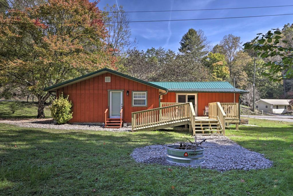 Escape to this warm and welcoming cabin located in the heart of Gatlinburg. This rustically furnished property boasts an inviting interior with Smart TVs, a full kitchen, mini-foosball table, plenty of board games, as well as an exterior with a private deck, gas grill, and a fire pit for roasting s'mores at sunset! Whether you're in town to hike in the mountains, explore Dollywood, or visit downtown Gatlinburg, this cabin is perfect. Mostly level lot with large storage shed, no steep mountain roads for access, and beautiful creek make this cabin ideal.