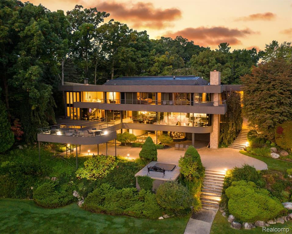 When you combine the brilliance of two Architectural Masterminds: Irv Tobocman and Lou Des Rosiers, the result is simply awe inspiring.  Add in a breathtaking view of all sports Upper Long Lake and it truly becomes a one-of-a-kind masterpiece situated on a 2 acre private elevated setting where majestic water views are incorporated into every inch of design. From the soaring span of windows, wrap around balconies and a floating two story deck, this home boasts architectural details unlike any other. Brilliant use of hardwoods, marble, glass and metals provide subtle, yet bold custom features that become an artistry in both function and form in a flowing open floor plan. Enter the Award Winning master suite and feel transported to the epitome of a 5 star hotel experience. Designed for a lifestyle of elegant and comfortable everyday living, it is also an entertainer's dream with a full walk out lower level, complete with a prep kitchen, bar, work out room and gracious recreational area.