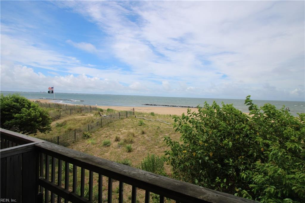 BAYFRONT! Beautiful 2 bed, 1.5 bath 3 story end-unit townhome w/180 view of both Sunrise AND Sunset (Dolphin viewing too). Oversized garage, carport, add'l parking, 2 balconies overlooking Chesapeake Bay, wood-burning fireplace, and full-size front-loading laundry. 2 mins I-64; 4 mins Norfolk Base, 15 mins Little Creek Base, 15 mins downtown, 28 mins VA Beach Oceanfront. Private beach access. Fully renovated in 2011, updates in 2014. 23' x 13' garage w/openers & overhead storage for SUP, kayaks, or surf boards. KitchenAid SS appls: refrigerator, dble oven, microwave hood, Under-counter & pendant lighting. Upgraded granite in kitchen and baths. WI shower w/sliding glass privacy doors. Front-loading Whirlpool W/D - Pella sliding doors and windows. Upstairs balcony off master bedroom large enough for full-sized furniture. Large downstairs balcony off living room large enough for patio set and grill w/outside storage closet. Enjoy this beautiful beach retreat!