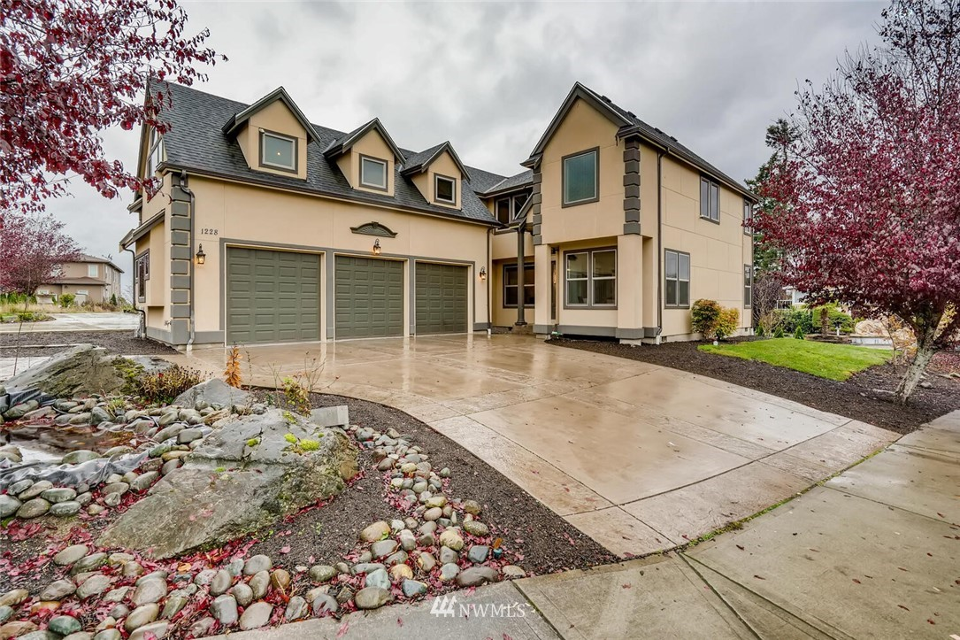 Come home to luxury and views of the Sound! This 2015 built home boasts 3,110 sq/ft, 4 bedrooms, a huge bonus room and oversized 3 car garage! Great open concept main floor plan features a gas fireplace and a 2 story wall of windows that flood the home with natural light. Gourmet kitchen with slab granite, gas cooktop, stainless appliances and pantry. Large master suite with 5 piece bath, 2 closets and views! New paint and carpet throughout. Located in cul-de-sac of newer construction homes.