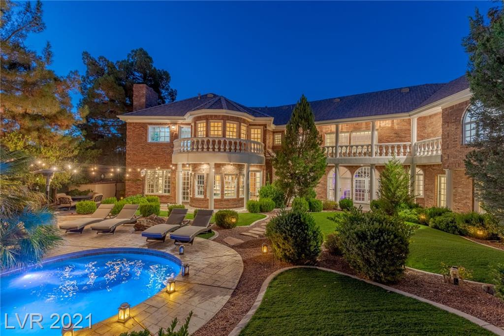 Discover incomparable privacy & outstanding amenities at this 2-story mansion, constructed w/real brick masonry on over 1/2 acre in an iconic, guard gated, Henderson community. Verdant rear yard w/Pebble Tec pool & spa. Grand entry. Formal living room w/23' ceilings. Chef's kitchen w/indoor grill, integrated Sub-Zero refrigeration, Jenn-Air double ovens, bay window dinette, & more. Formal dining room. Bonus room w/step-up wet bar & wine cellar (ideal for a game room or theater). Upper-level owner's suite w/sunken sitting room, expansive bedroom, 2 large closets w/built-ins, & access to front & rear balconies. Primary bathroom w/sparkling marble, double vanity, freestanding bathtub, & oversized shower. Spacious office w/hardwood built-ins. Generous loft space. 4 fireplaces. Smart home technologies include Nest thermostats, Ring doorbell, Pentair pool control, infrared sauna, & dimmable, color-changing Leviton lighting throughout the home. Horseshoe driveway & gated motor court.