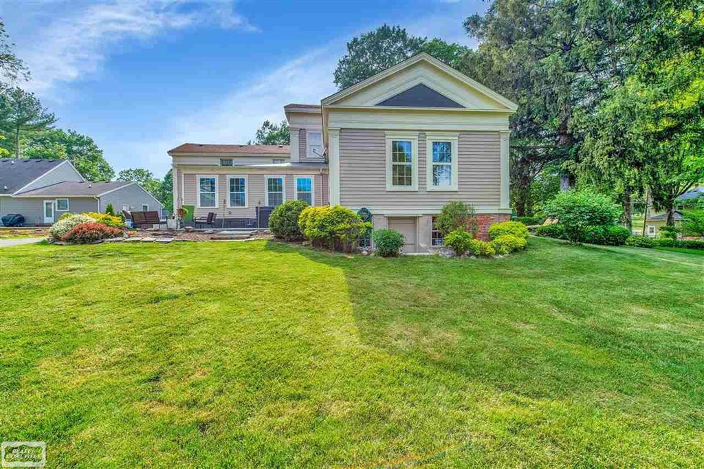 """""""A work from home paradise"""" features enormous detached Garage w/Bonus-Room & Covered Side-Porch. """"Master Suite"""" on main level has private entrance to a lovely covered porch (once was a home office entry) could be an ideal, discreet business entrance + 2nd stairwell gives private access to a 5th upstairs Bedroom (another ideal office space.) Amazing 11' ceilings, Original Hardwood, double stacked Crown Molding, authentic embellished Plaster Ceilings & original fixtures.  Updated Tall Maple Cabinetry, Quartz counters, Built-in Range/Oven, Huge Walk-In Pantry & large 1st Floor Laundry! All-Season Room overlooks nearly 1-Acre.  Entertaining or relaxing on 2 patios. Professionally painted inside & out; Freshly updated Baths, Impressive tall MI Basement w/ Cellar Door is structurally certified w/ newer Block Windows. High on a hill, published as the Romeo Cover in the Historic Romeo Review, proudly boasts only a few owners in it's Historic Record.  A grand home & ideal live/work opportunity!"""