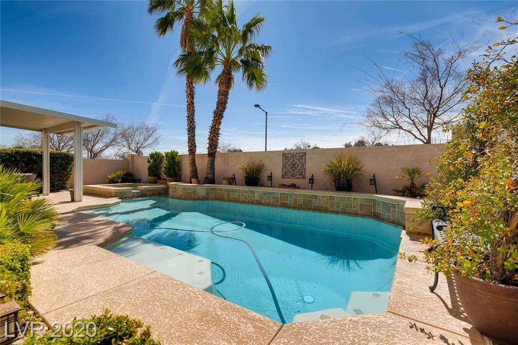 Awesome 4 Bedroom Summerlin Pool Home with 3 car garage under $500,000 / 1 Bedroom and full bath downstairs 3 bedrooms and 2 baths plus a loft upstairs / Upgraded flooring / Kitchen Appliances upgraded / Oven and Microwave/Convection Oven as well Built in Wine Fridge in the Kitchen Island / Upstairs AC updated in 2018 / New Pool plaster in 2020 / New water heater in 2019 / MAKE SURE TO CHECK OUT THE MATTERPORT VIRTUAL TOUR LINK