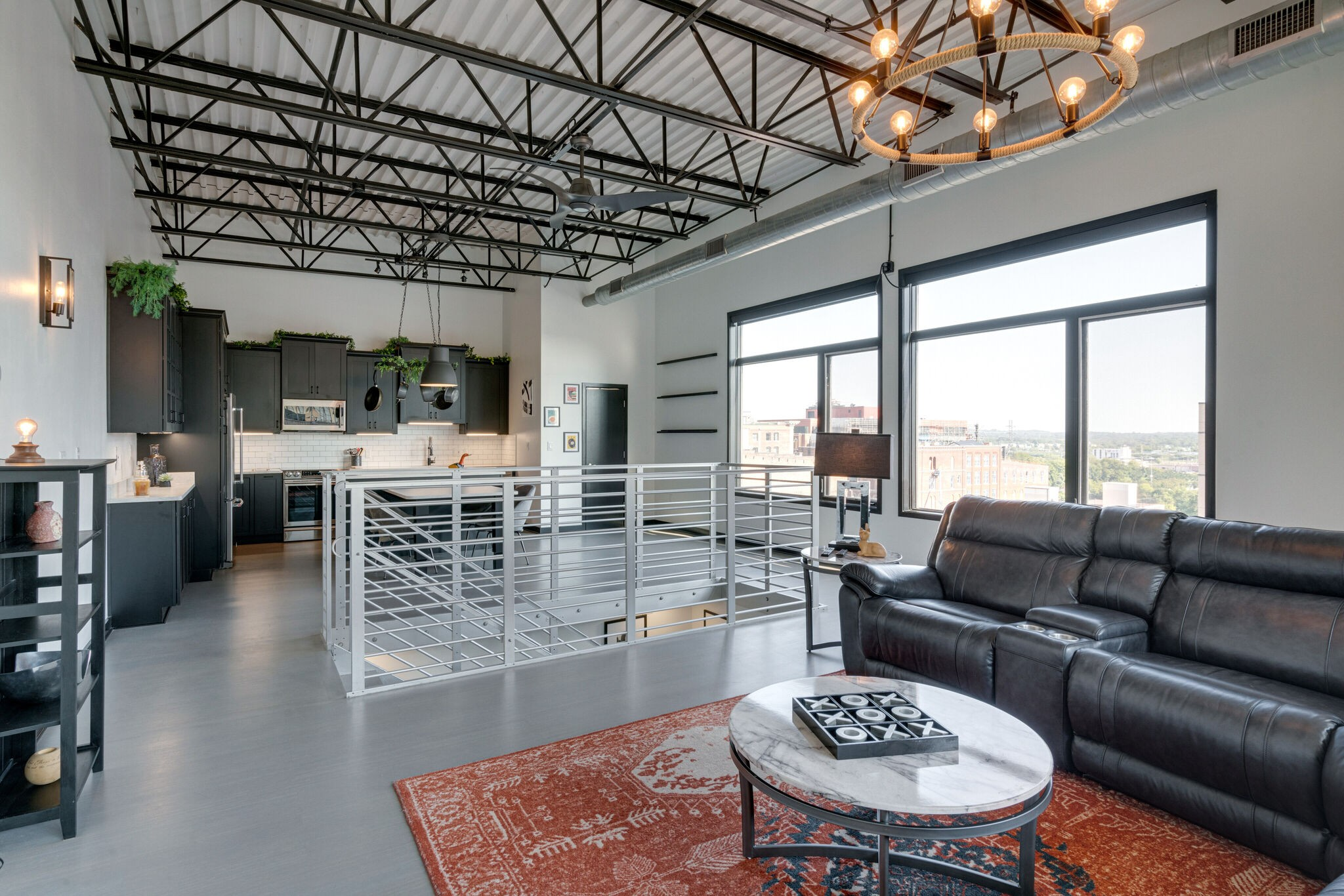 Right in the heart of Downtown Nashville, steps away from Printer's Alley:  Unique two story fully renovated from top to bottom - new HVAC.  Sold fully furnished:  Furniture, decor, art, tv's, bedding & kitchen dishes/utensils.  Two balconies w/great views, 2 reserved parking spots.  Remote controlled UV blocking shades.  Quartz countertops kitchen and baths.  Turn key ready!