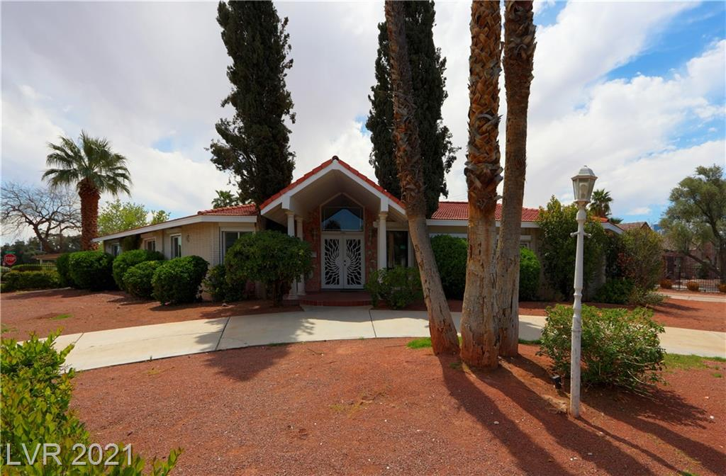"""THIS HOUSE IS A MUST SEE!! SPECTACULAR VINTAGE VEGAS ONLY MINUTES AWAY FROM THE STRIP!!! Loads of upgrades have been done to this home while still preserving the dazzling classical design.  Including a full service bar in the family room in original condition with original bar stools!  You can picture the """"Rat Pack"""" hanging out here.  All of the floors have been upgraded to marble and hard wood with original carpet in the living area in superb condition. Upgraded lighting and crown molding has been installed throughout the house.  All the windows have been recently replaced with a lifetime warranty.  AUTOMATIC SECURITY SHUTTERS ON ALL THE WINDOWS AND GLASS DOORS!! Owner paid extra to be able to control each individual shutter with a remote in each room of the house! Original wall paper with matching drapes, goal plated fixtures with imported marble!  Huge fenced yard with round driveway.  Pool area has it's own shower room!  This house will not last!!"""