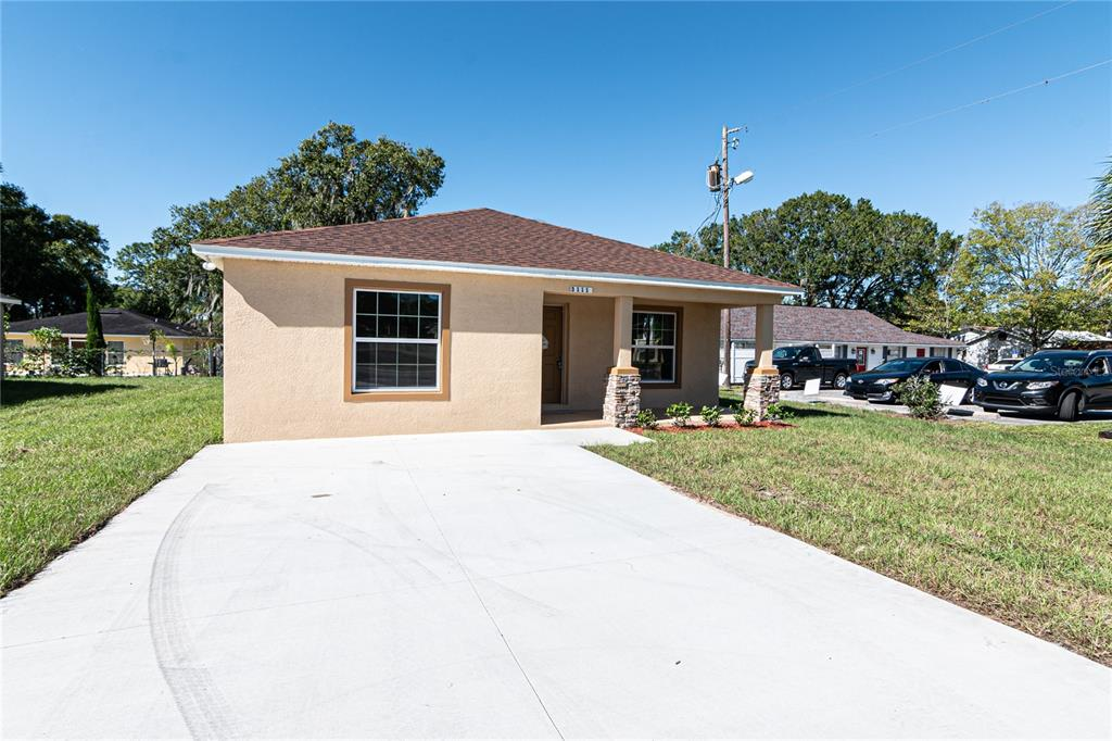 Under Construction. Under Construction. ***Completion Date END OF September.*** Brand New concrete block 3 bedroom, 2 bath, 1,385 SF bungalow, located in the growing downtown Plant City area. Our popular Heritage Model includes a 6 x 15 covered front porch with stacked stone pillars. Covered rear 10 x 8 Lanai & storage room located just off the kitchen. HUGE 15.8 x 14 Master Suite, 15 x 16 Great Room 12 & 16 x 9 formal dining area. 10 ft breakfast bar, Custom Crafted kitchen & bath cabinets Granite countertops, Delta faucet plumbing trim package, New Frigidaire appliance package, White Subway Shower Tiles in both baths, 50 energy-efficient LED can lights throughout, Argon Gas filled double-paned vinyl windows, 30-year Dimensional Shingle roof & Energy Efficient AC with 5 years manufactures warranty. ** No HOA or CDD, 5 Minutes from I-4 for easy access to dining and shopping. ***Pictures are of a previous build.***