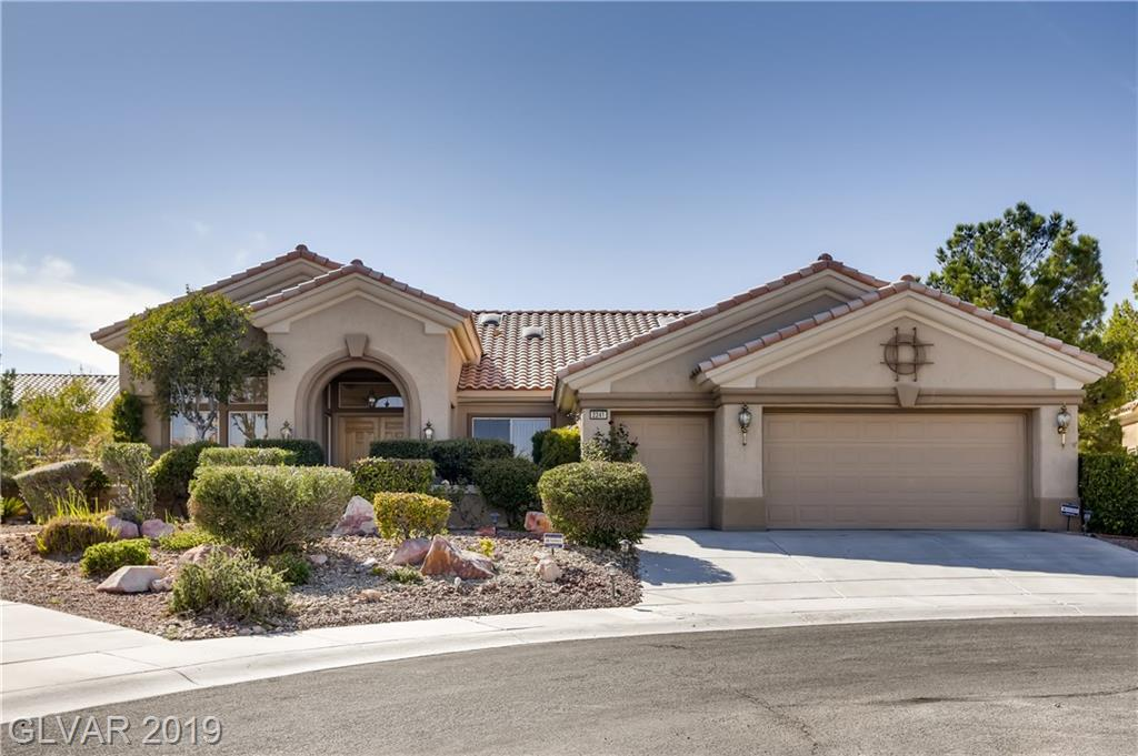 Beautiful Sun City Summerlin home: 2545 sqft on oversized cul-de-sac lot; fresh paint; 2 bedrooms (Den can be used as 3rd bedroom) & 2.5 baths; formal living & dining rooms; large kitchen w/upgraded cabinets; 2 fireplaces, upgraded carpet & pad; jacuzzi tub. Even an epoxied garage floor and covered patio. Baths have onyx counters; Mbath has separate shower/tub.  And all the amenities of Summerlin.