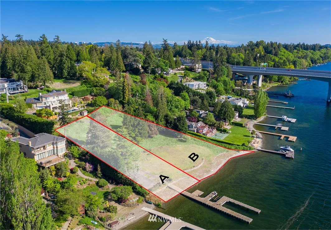 The Evergreen Point Legacy Estate is two separate but adjoined buildable lots comprising approximately 1.4 acres and 232 lineal feet of west-facing waterfront on Evergreen Point Road. It's a blank canvas, and the largest remaining buildable lot on any of the Eastside's coveted waterfront points.  Your dream estate is limited only by your imagination.
