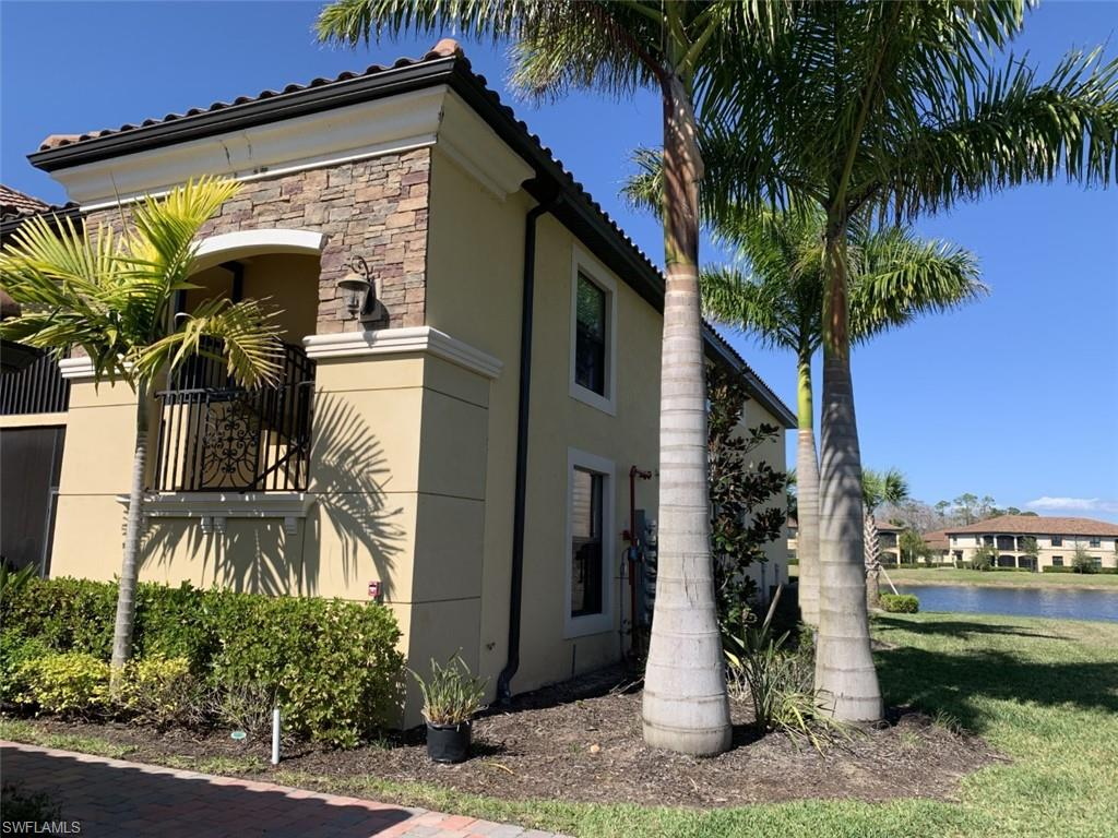This is a Veranda End Unit in Avellino!  Rarely on the market and the last building at the cul-de-sac!  Very quiet and with great lake views as well as a conveniently located detached one-car garage.  Currently set up as a 3 bedroom, as the den is large and has a large window.  Cathedral ceilings, open floorplan and with more square footage and a different floorplan then the interior Verandas units.  The front and rear lanais are perfect for enjoying winter and summer weather as well as providing more privacy.  Avellino Veranda Condos do not have a golf membership and also no additional golf dues.  The course is available in the off season for resident play as available.  The Social Membership, included in your Master dues, gives an owner access to all of the Treviso Bay amenities and restaurants, the spa and gym as well as the superb tennis facility.  Great for the second home owner looking for the perfect getaway at a TPC golf community, minutes from Naples!!